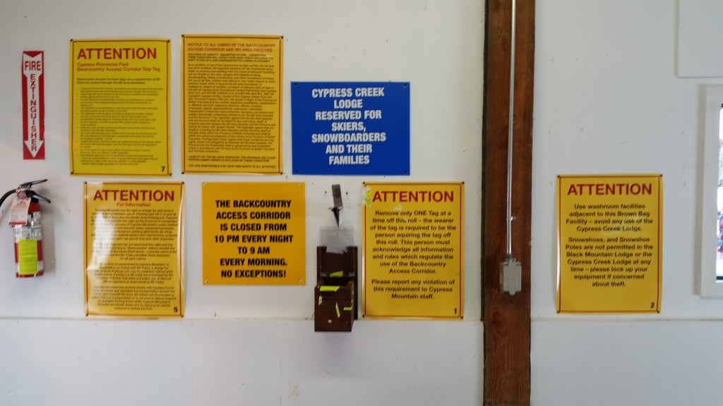 A photo depicting the signage at Cypress' (old) Black Mountain Lodge Brown Bag Room. All backcountry users are mandated to carry a yellow Backcountry Access tag/waiver, which gives them Legal Visitor status and enables them to cross the CRA (although it says in the small print on the tag that they should carefully avoid colliding with any snowboarders!)